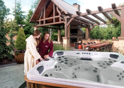 A couple setting up a hot tub